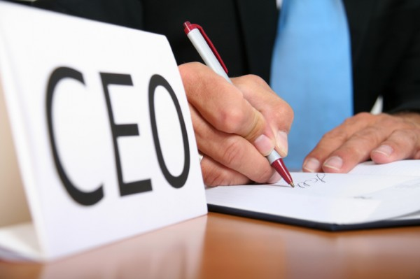 CEO-signing-contract