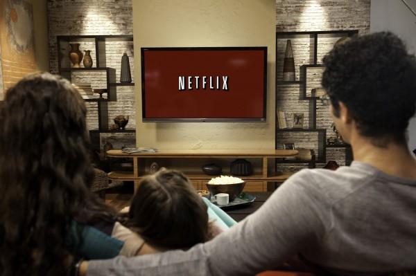 Family in living room 4 - Netflix Logo on Red