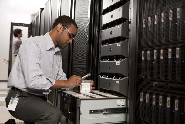 Man in front of Dell Rack Servers